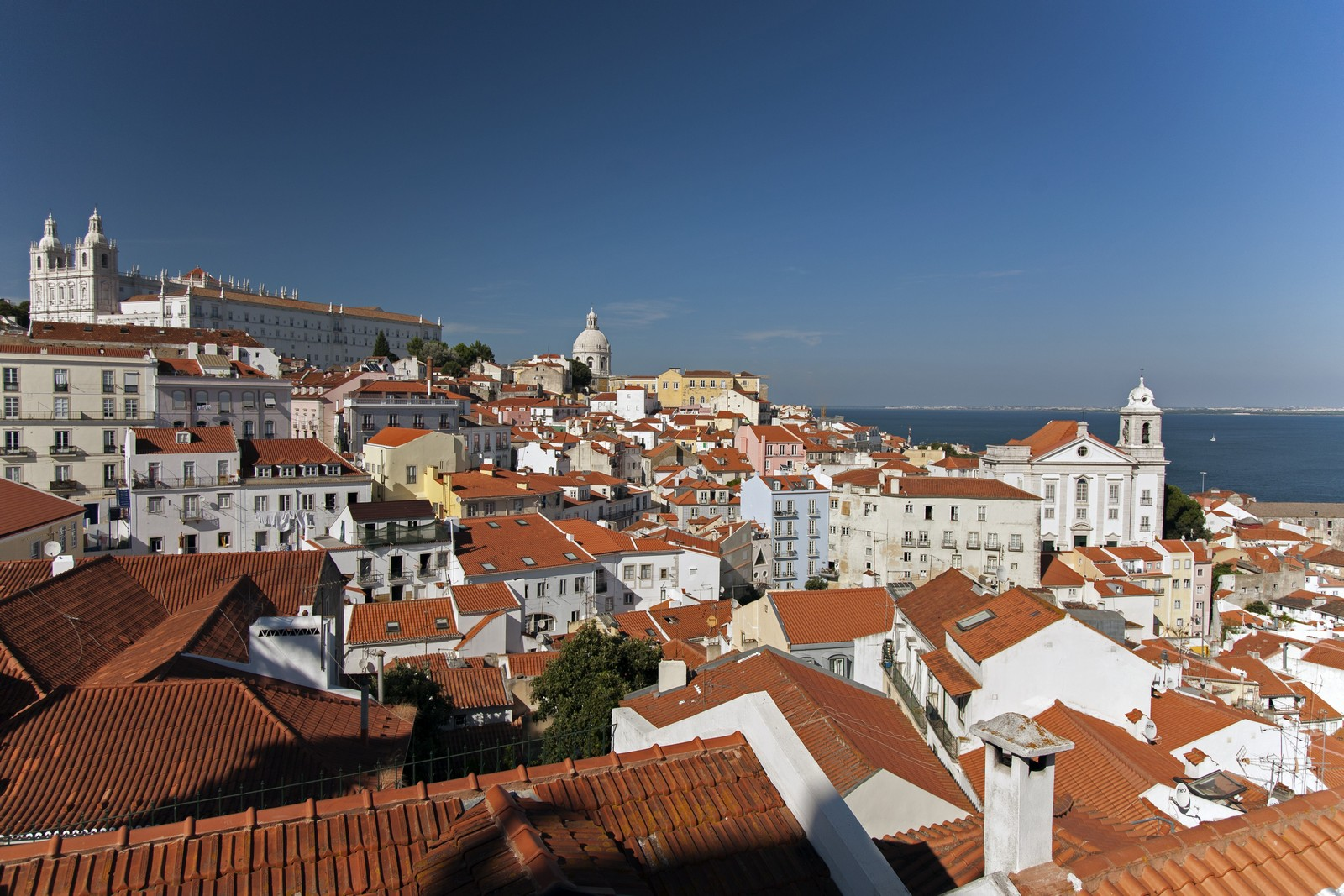 lisbon-alfama-hill-tagus-river by Essencia da Latitude