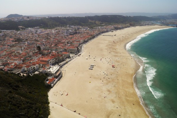 Nazare beach by Essencia da Latitude